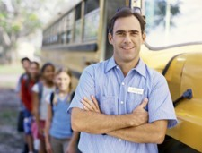 Bus driver with kids in background_300.jpg
